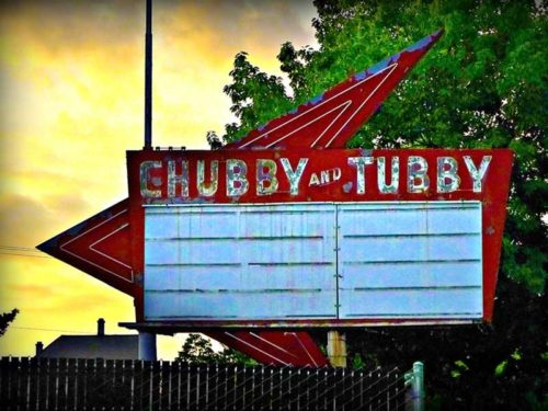 Chubby & Tubby rusting metal sign